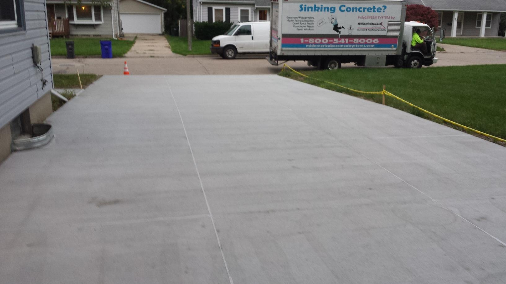 Full view of the driveway after it has been lifted and then sealed.