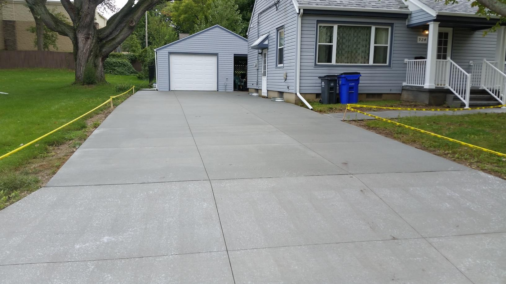After the driveway has been sealed and completed.