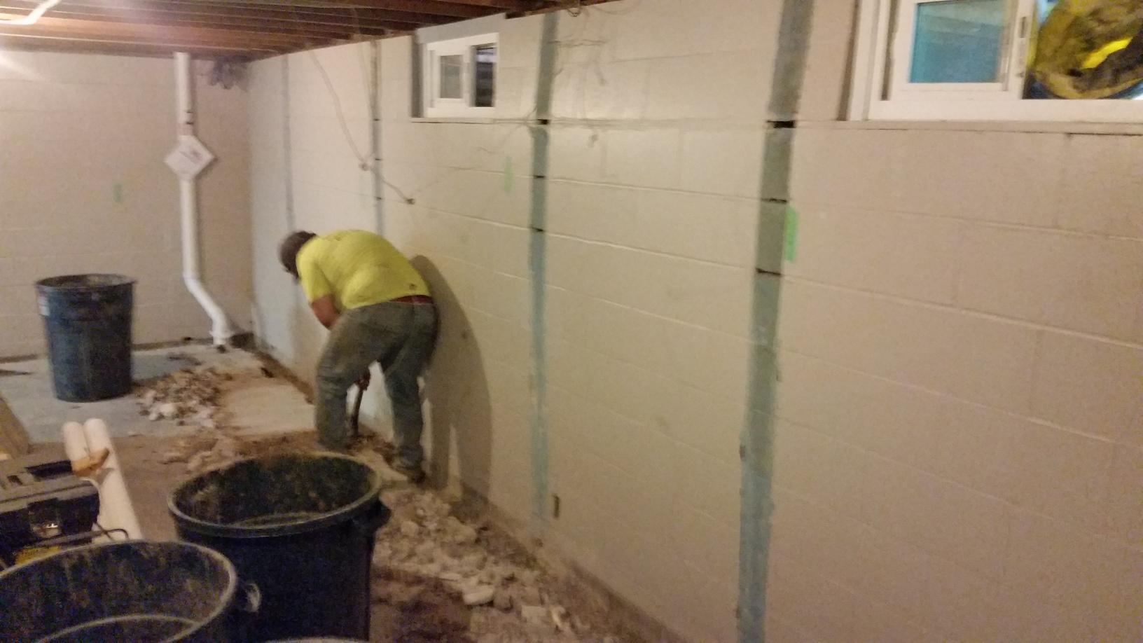 The basement walls were bulging and needed to be addressed as soon as possible so that they would not get worse.