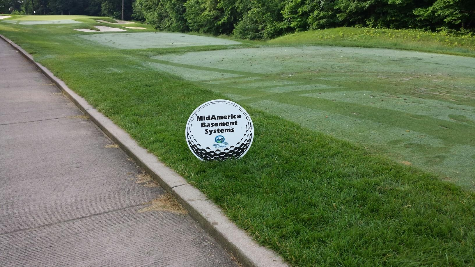 MidAmerica Basement Systems sponsorship sign for the 2014 Quad Cities Chamber annual golf outing.