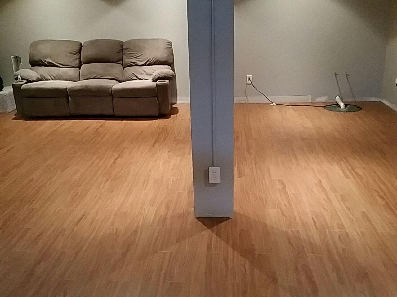 ThermalDry flooring is available in two different finishes, Light Pecan, and Dark Walnut.