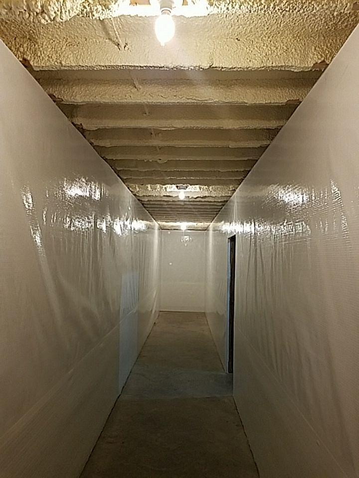 The vapor barrier will stop water from continuing spreading throughout the walls and will drain any wall leaks.