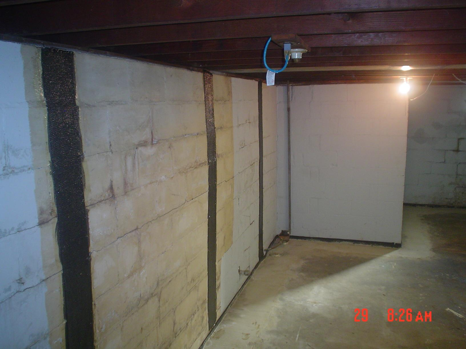 CarbonArmor wall straps fulled installed on foundation walls to prevent further bowing.