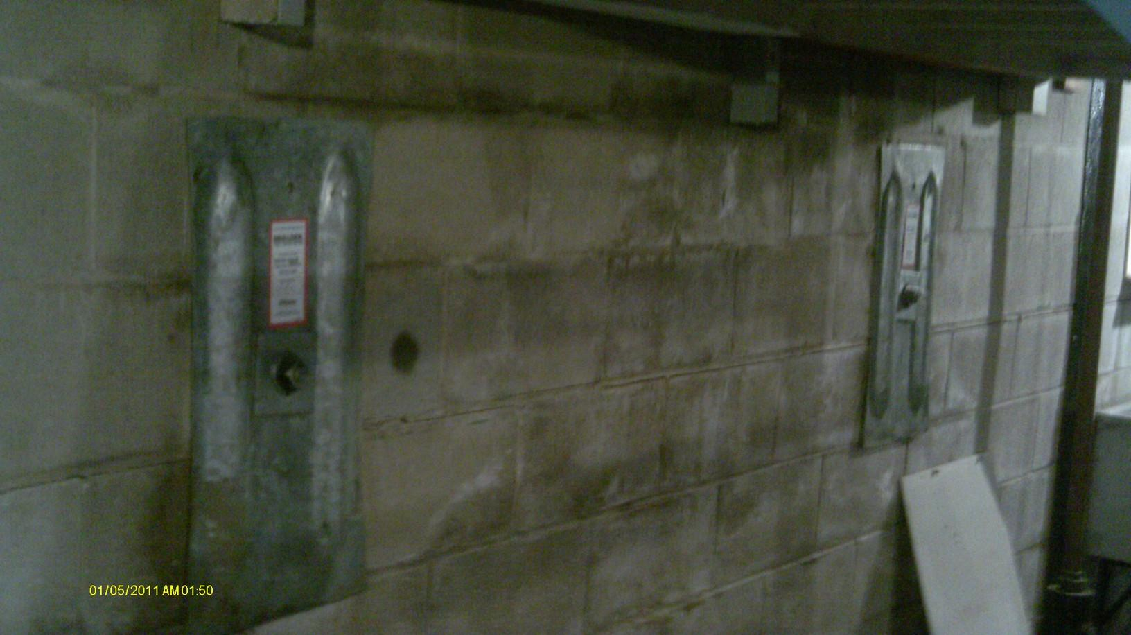 Wall anchors installed to prevent further bowing.