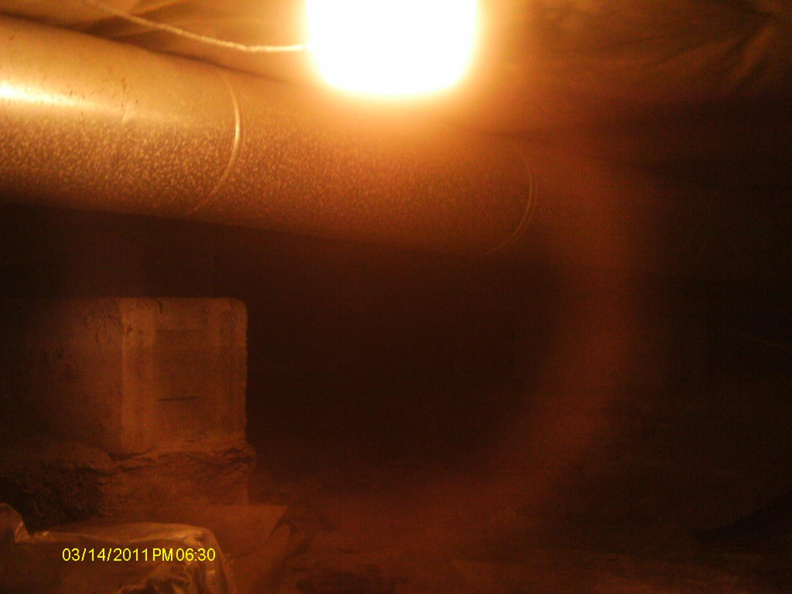 The crawl space before encapsulation reveals exposed earth, perfect situation to allow radon to seep in from the ground and circulate through out the house making the home hazardous for the occupants.