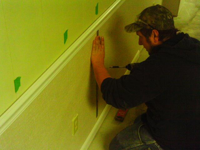 The EverLast Wall Restoration panels are secured with steel studs by a professionally trained MidAmerica Basement Systems expert.