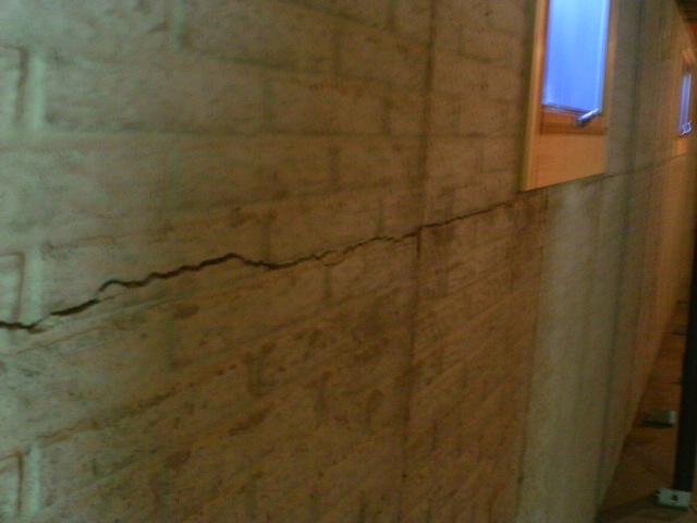 The crack along this wall is a clear sign of a serious problem.