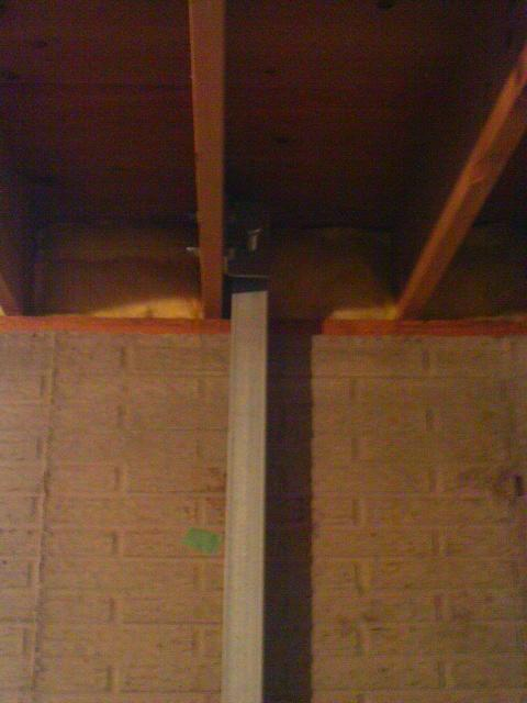 The team connects the system to the floor joist. Power Brace utilizes a joist reinforcement method which distributes the load evenly as to not damage the wood floor system.