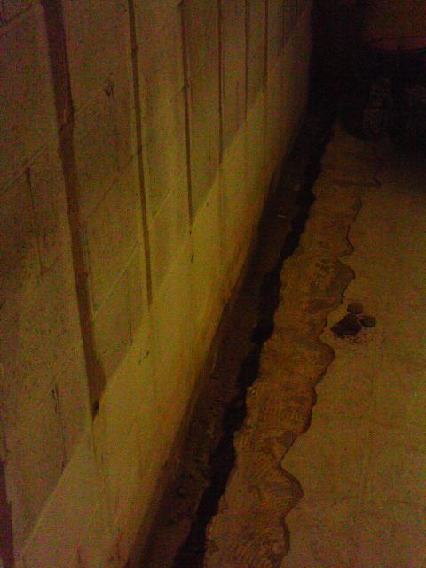 To waterproof the basement, the team installed WaterGuard as the perimeter drainage system. WaterGuard is installed on top of the foundation footing to prevent clogging. It has a built in gap between the floor and wall to drain wall leaks to the local sump pump