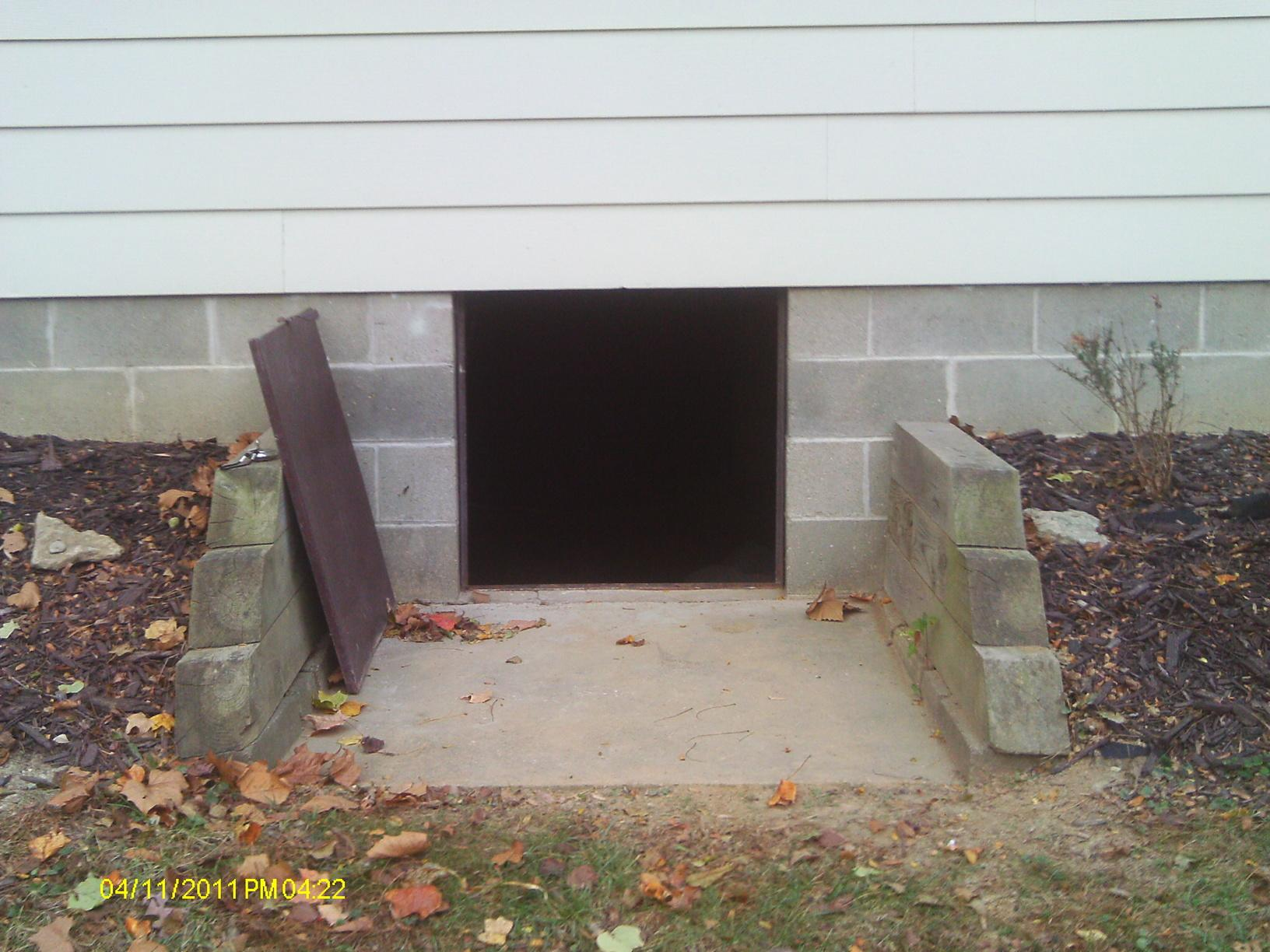 Entrance to the crawlspace. The team does it's best to cause minimal disturbance to the home and so will typically designate one entrance/exit during the project.