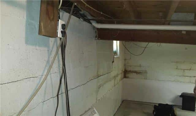 Wall Anchors Stop Wall from Bowing in Dixon, IL Basement - Before Photo