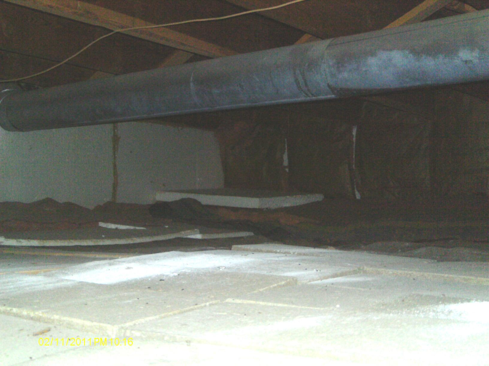 This crawl space was dirty, damp and drafty.
