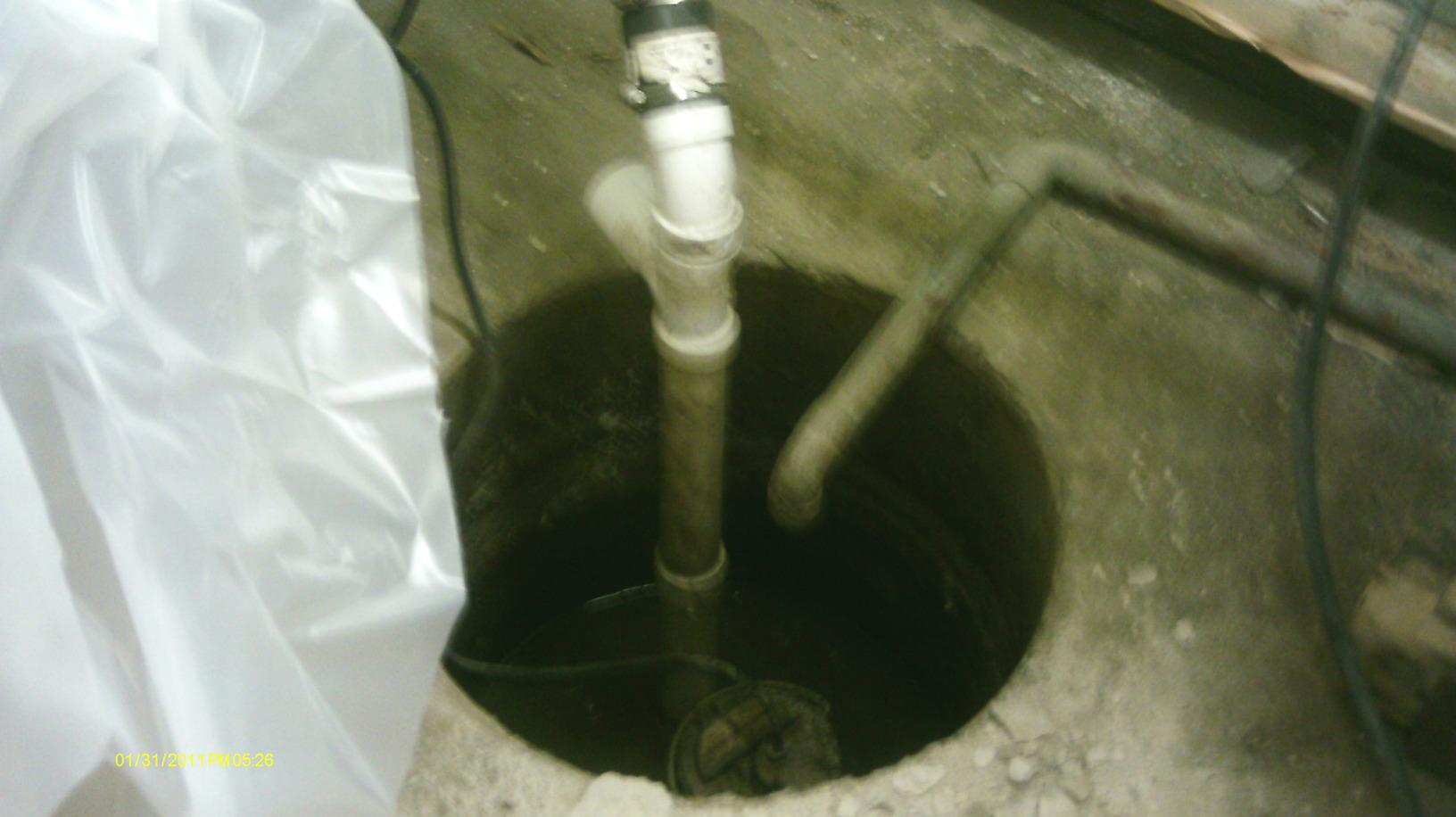 The old sump pump is inefficient and allows water vapor to rise into the basement, adding t the general dampness of the space.