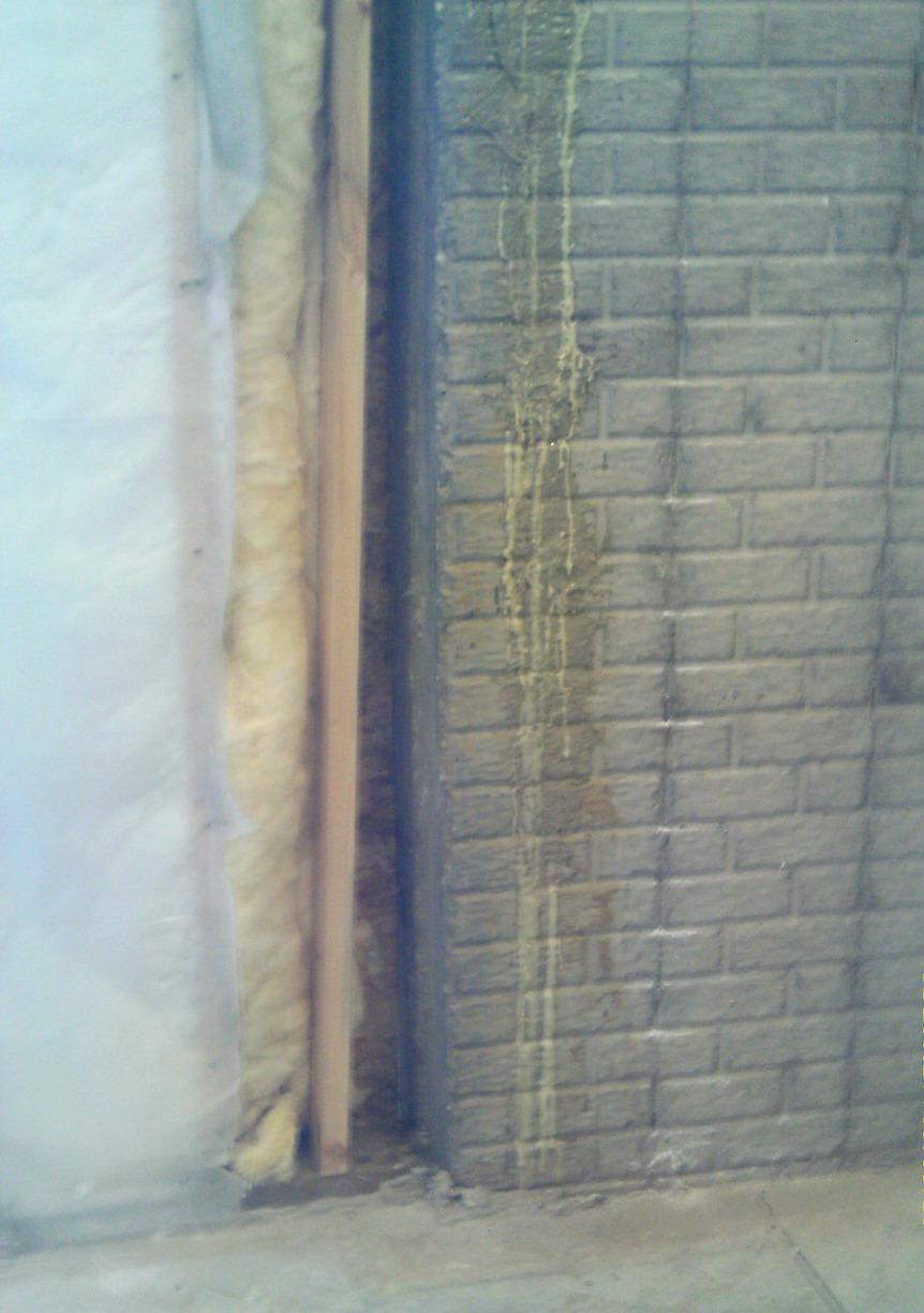 The cracks allowed water to drip down the walls, leaving unsightly trails of water intrusion/damage.