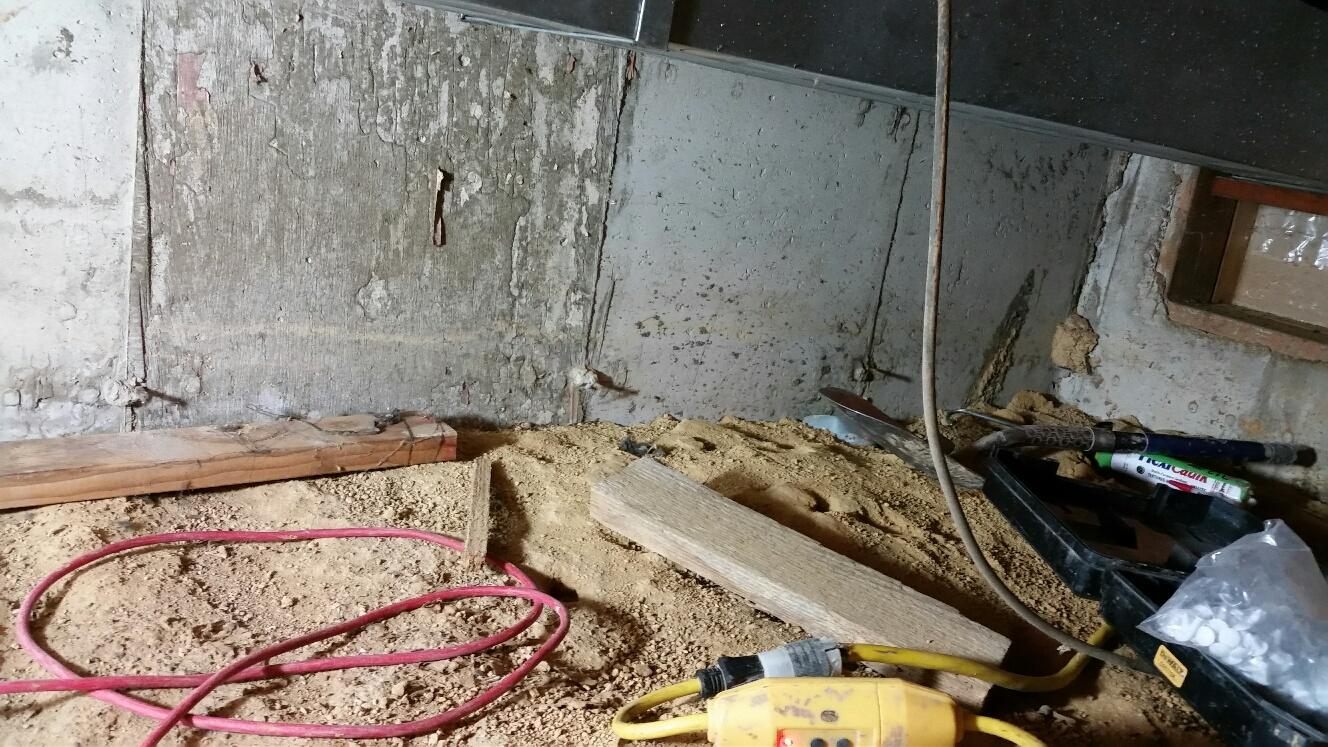 The crawl space before was filled with debris.
