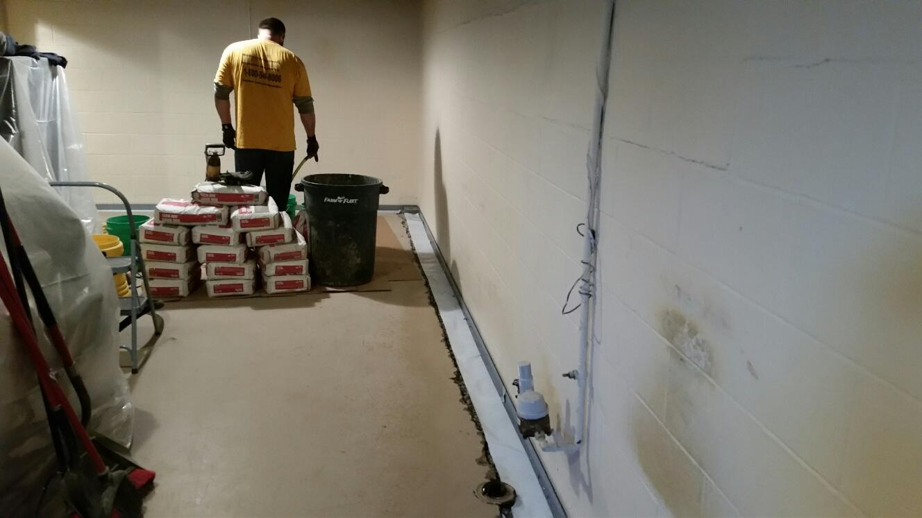 When the SuperSump and WaterGuard are secured in their positions, the team pours concrete to level the systems to the rest of the foundation floor for a smooth finish.