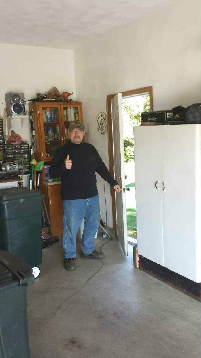 The homeowner was so happy with closed cracks, working doors and stable foundation he gave the team a thumbs up!