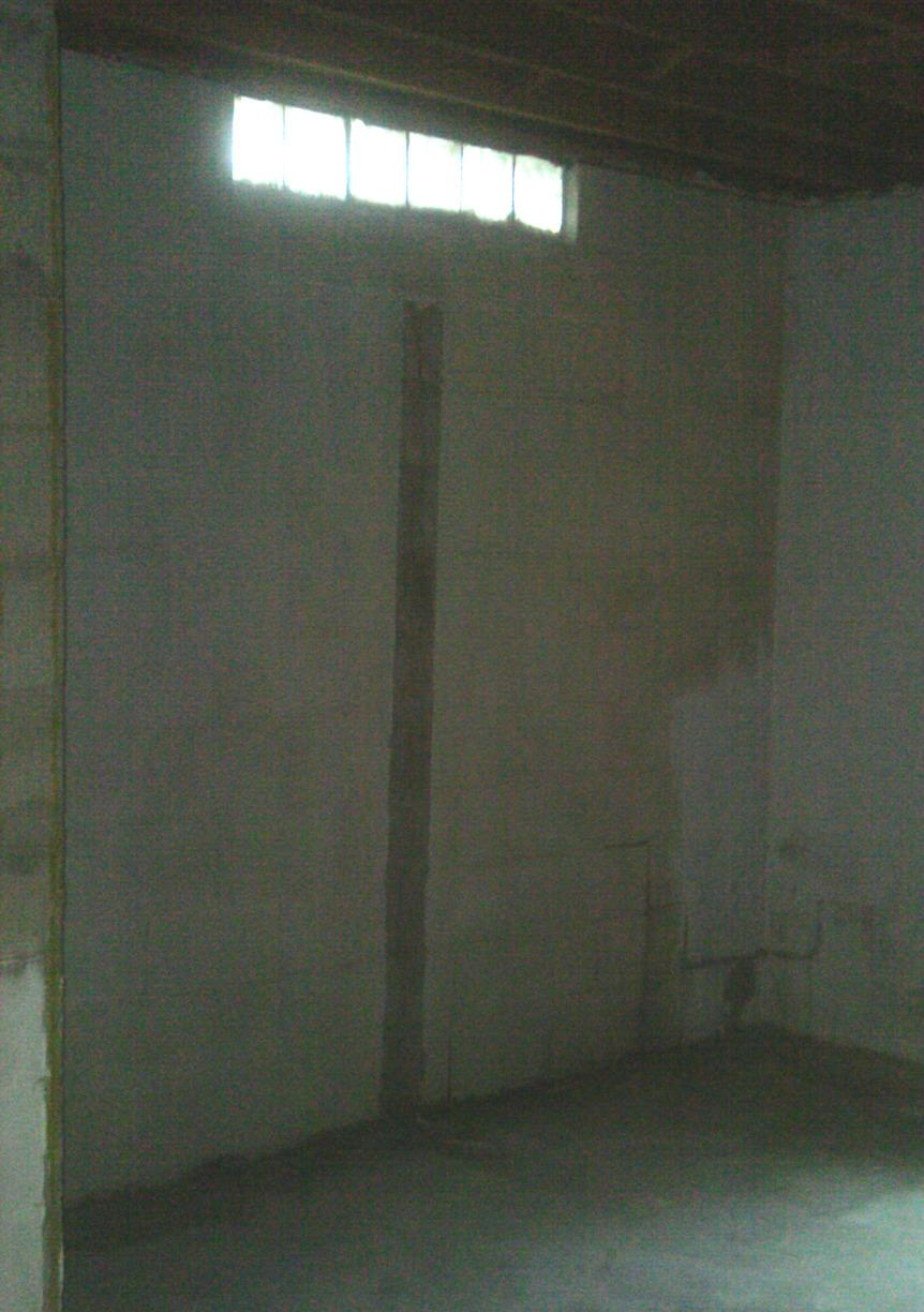 Repeated water intrusion coming from the bottom of the walls.