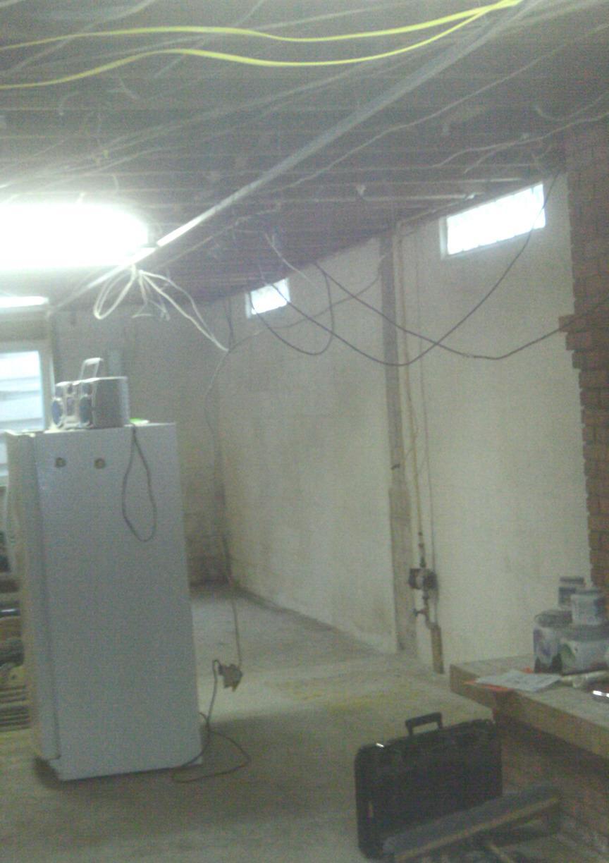 The basement before Basement to Beautiful panels.