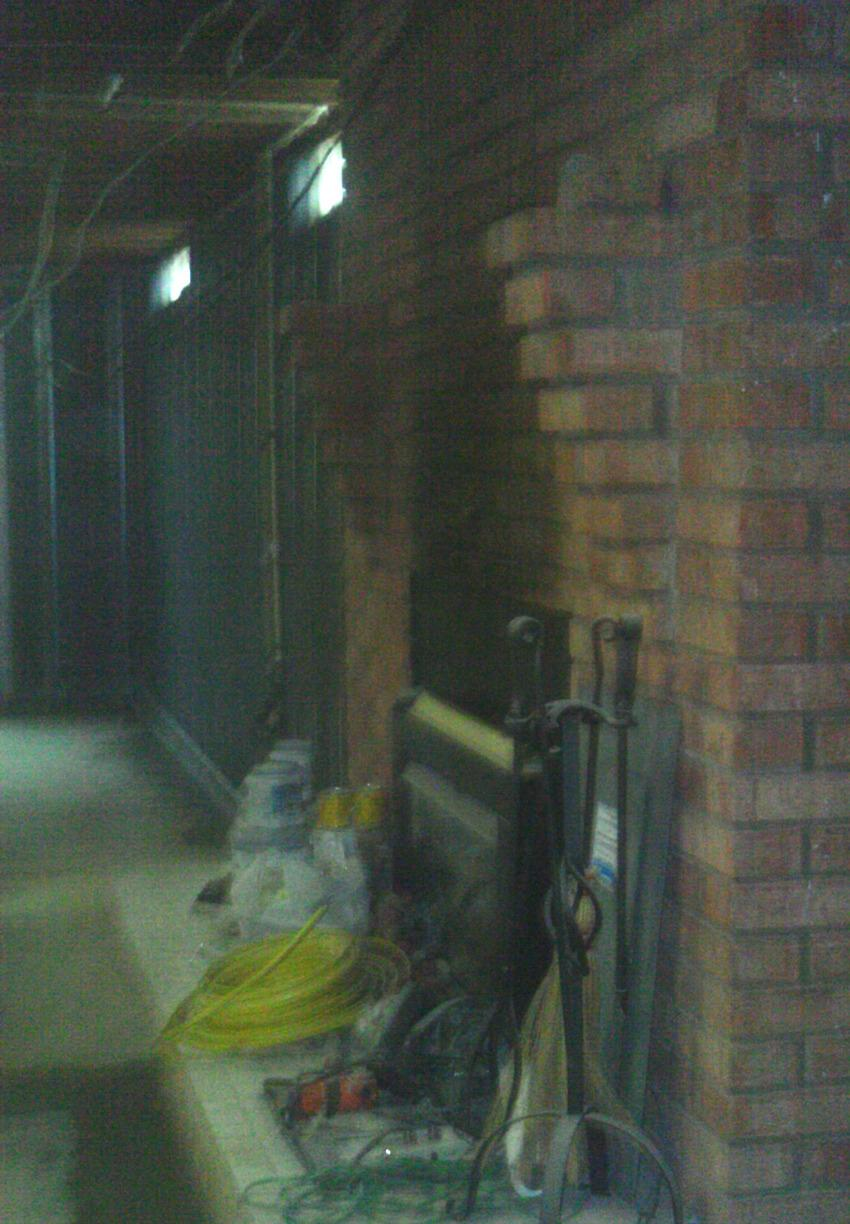 The team was able to work around the fireplace ensuring the entire perimeter is waterproofed.