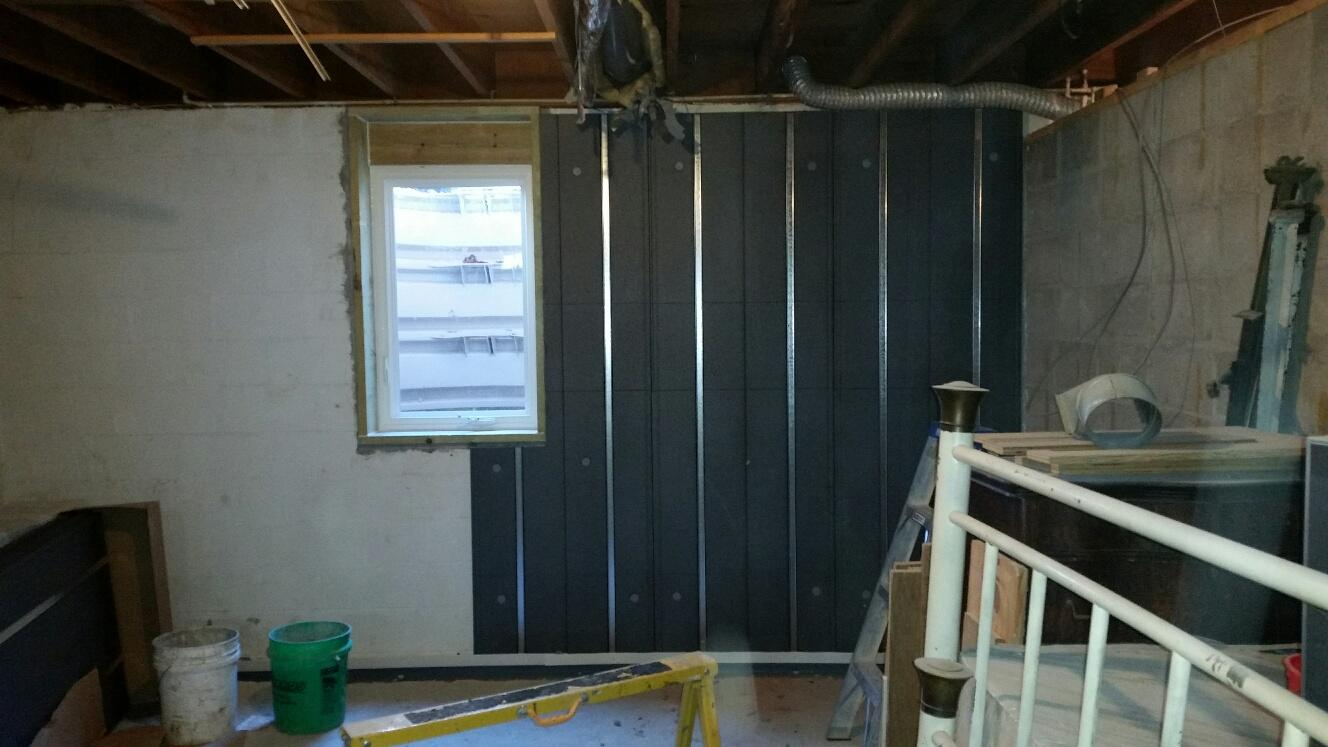 Now that the basement is stabilized and waterproofed the team can begin installing the Basement To Beautiful panels.