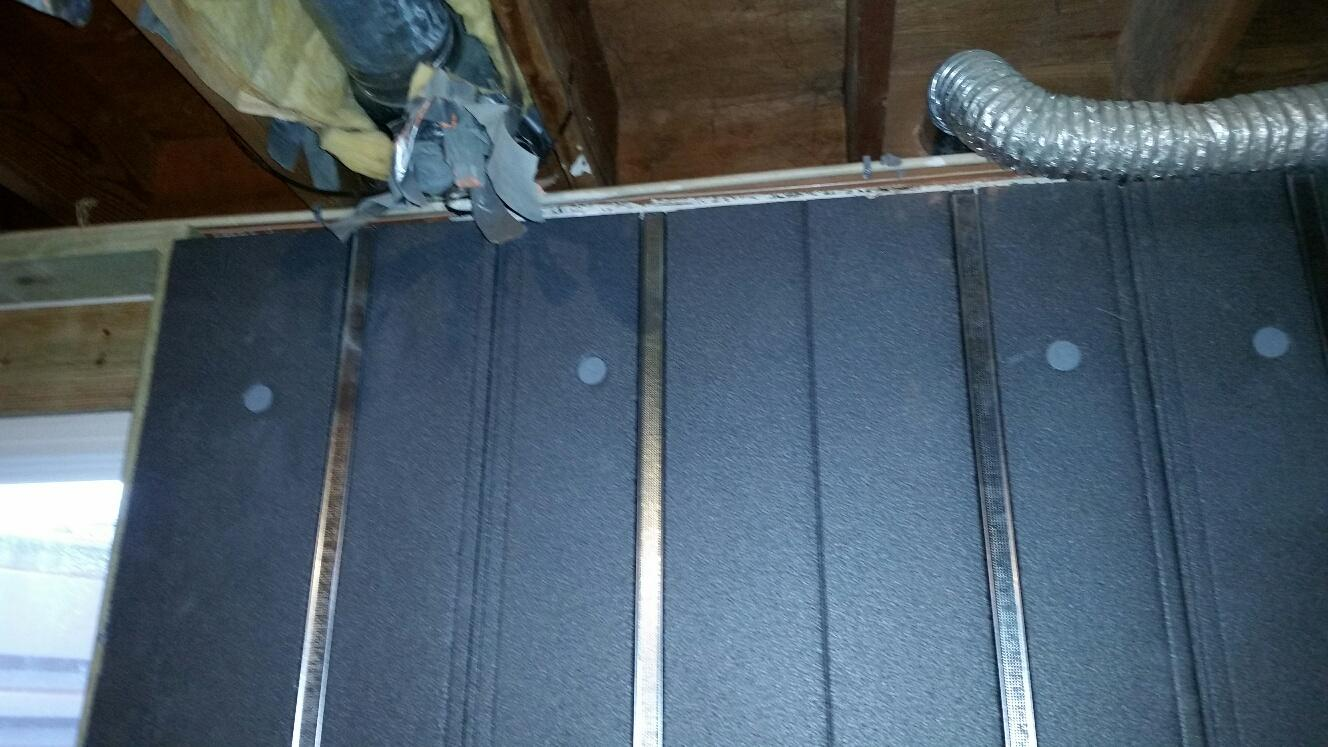 Metal studs are integrated with the foam -- and do not touch the concrete basement walls through the foam.