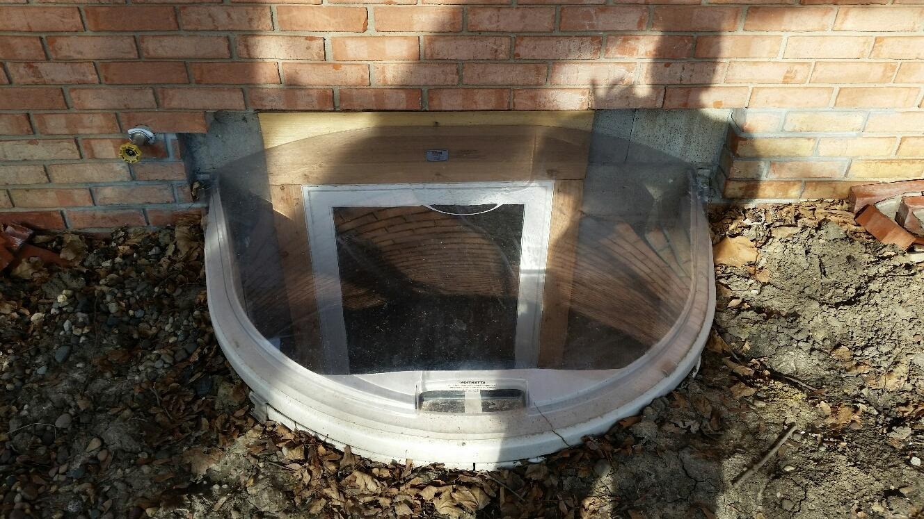 A durable, clear plastic dome finishes the window installation.