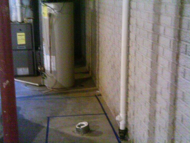 The area before waterproofing was susceptible to future water intrusion, especially with utilities that are prone to leaks such as a water heater.