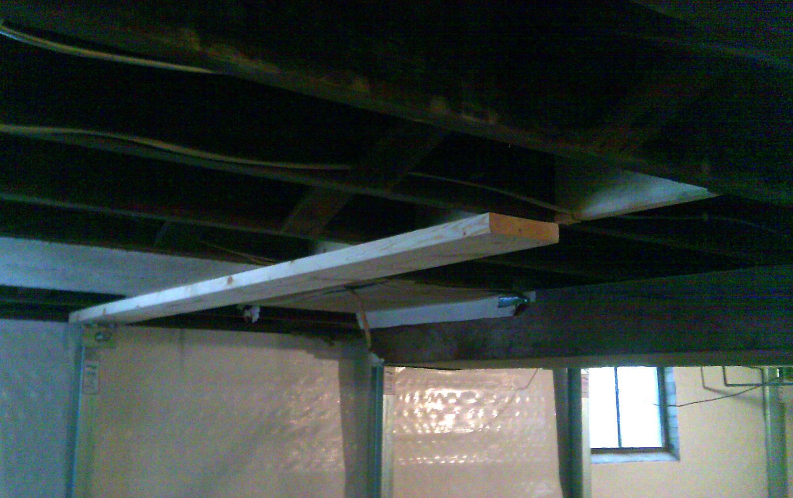 The team constructed joist reinforcements to secure the installation of the PowerBrace system.