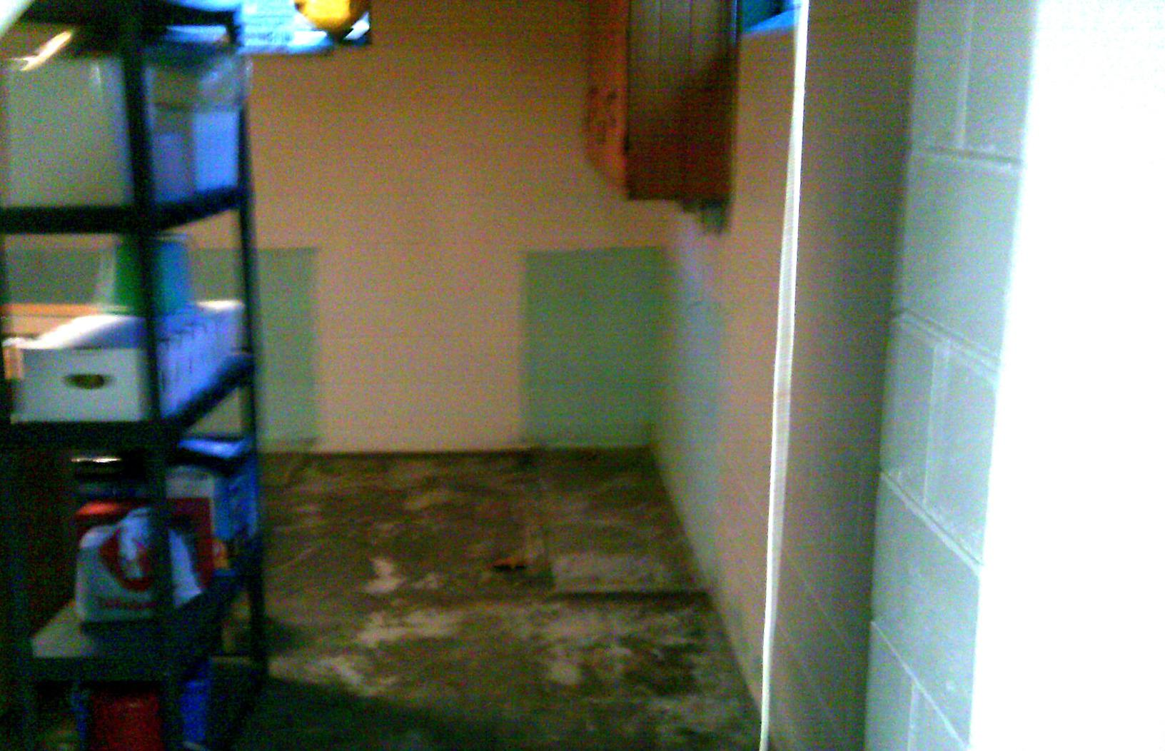 The basement before waterproofing was damp and prone to leaks.