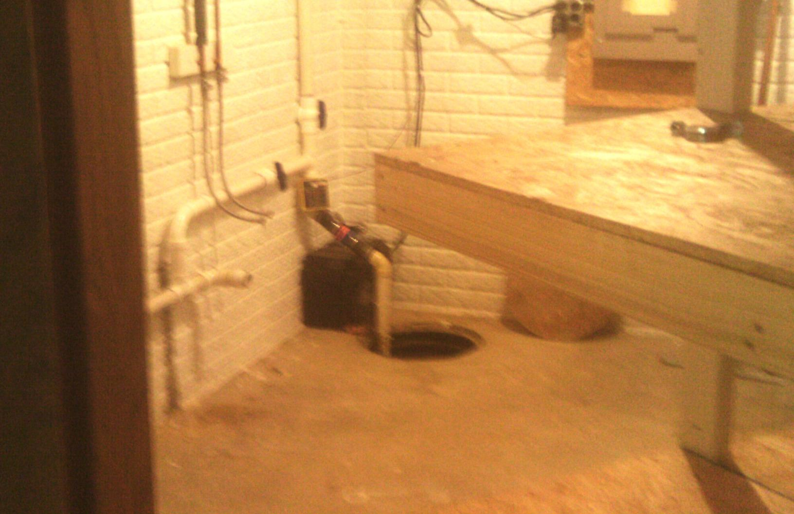 The previous sump pump was open, among other flaws, which allowed water vapor to rise into the basement