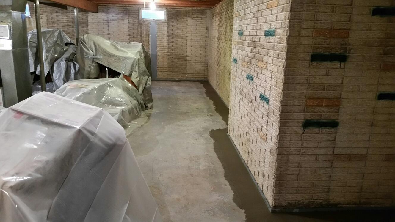 Once the team installs the Waterguard system, they pour concrete to level with the foundation floor.