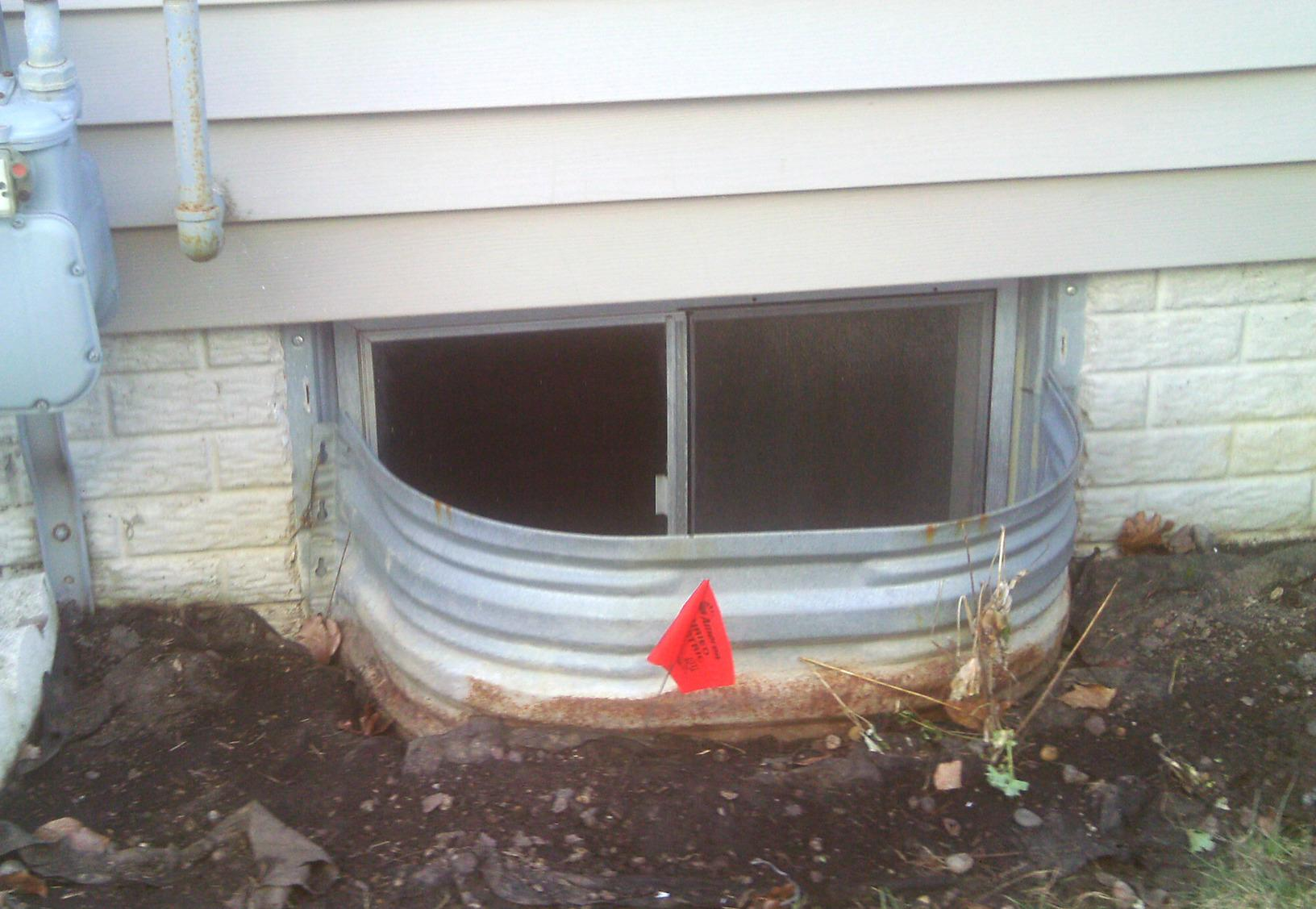 The window system covering this egress did little to keep the elements out and was an eye sore.