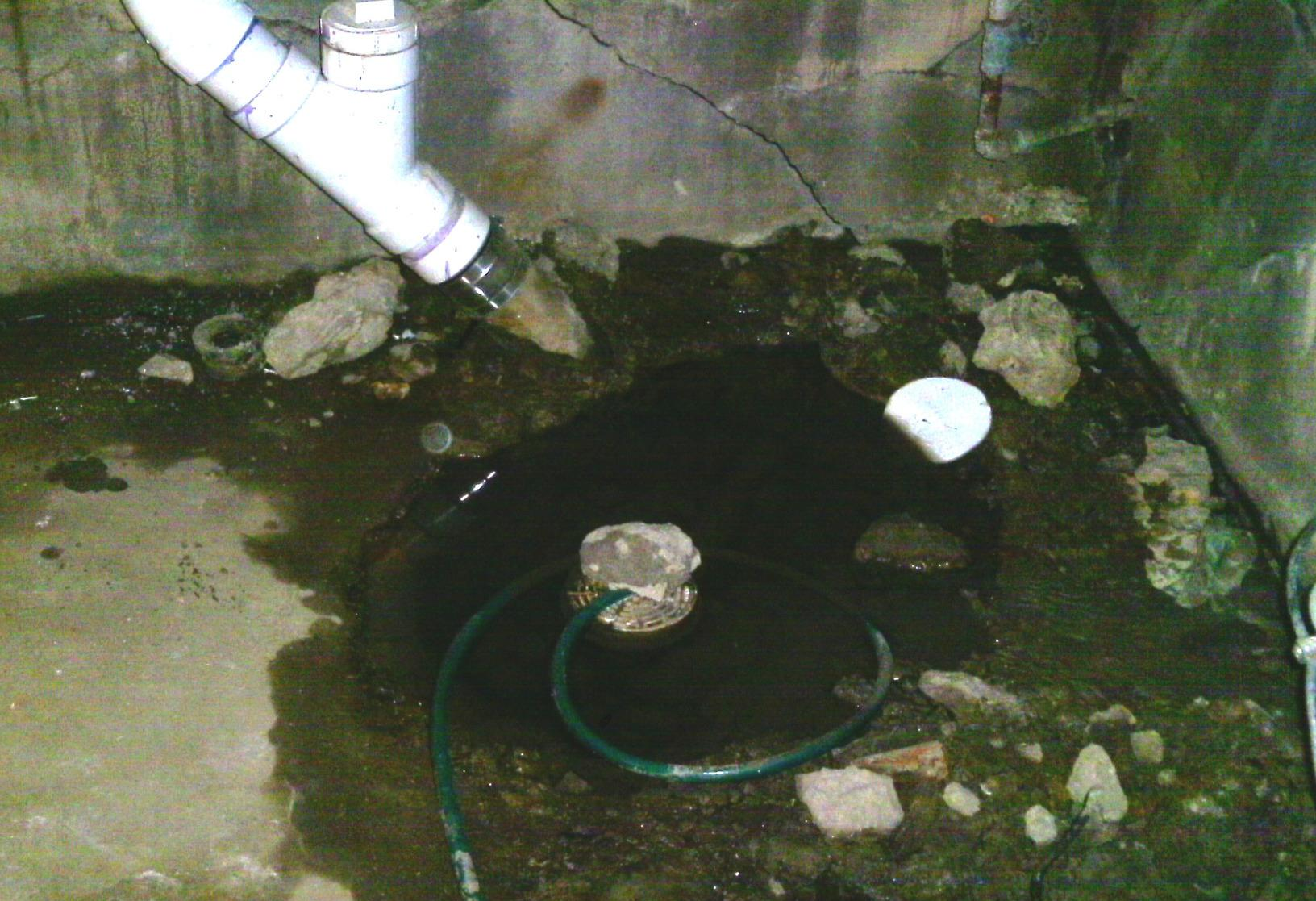 The previous homeowner made a make shift sump pump in an attempt to waterproof the crawl space, an endeavor that ultimately failed.