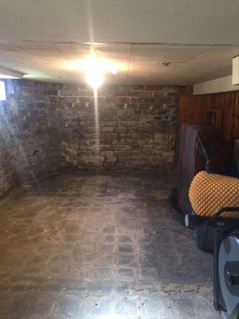 The basement was damp and dingy before waterproofing.