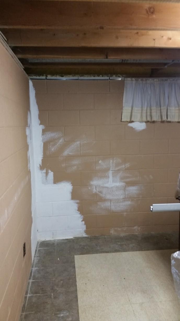 The owners tried to paint over some of the water damage.