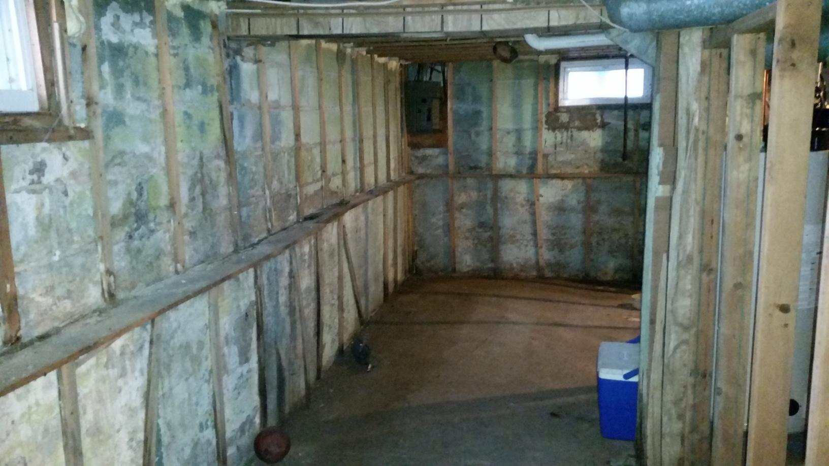 The basement before waterproofing was in need of waterproofing after repeated water intrusion.