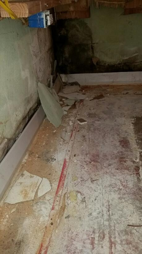The old drainage system was supposed to catch wall leaks and direct water away from the foundation floor.