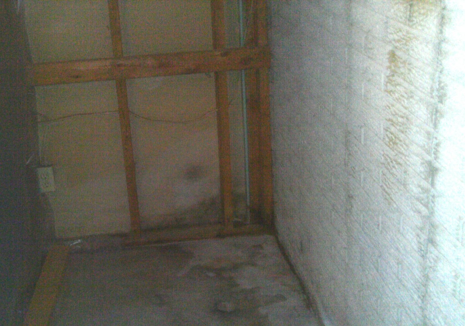 Becasue of repeated water intrusion, this basement sustained some visible damage on the walls and floor of the basement.