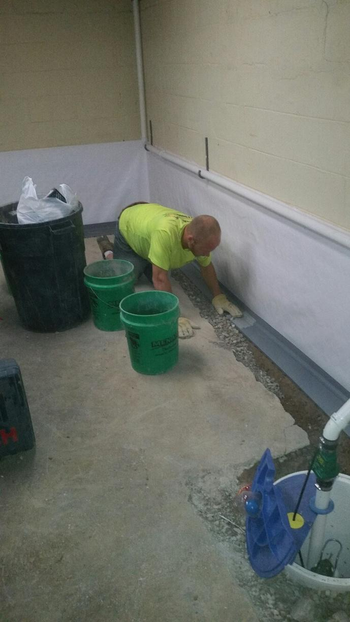 MidAmerica Basement Systems professional installing WaterGuard.