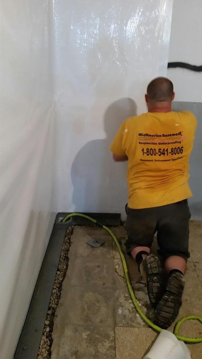 Here, the team is working on installing CleanSpace, a vapor barrier, in Cedar Falls.