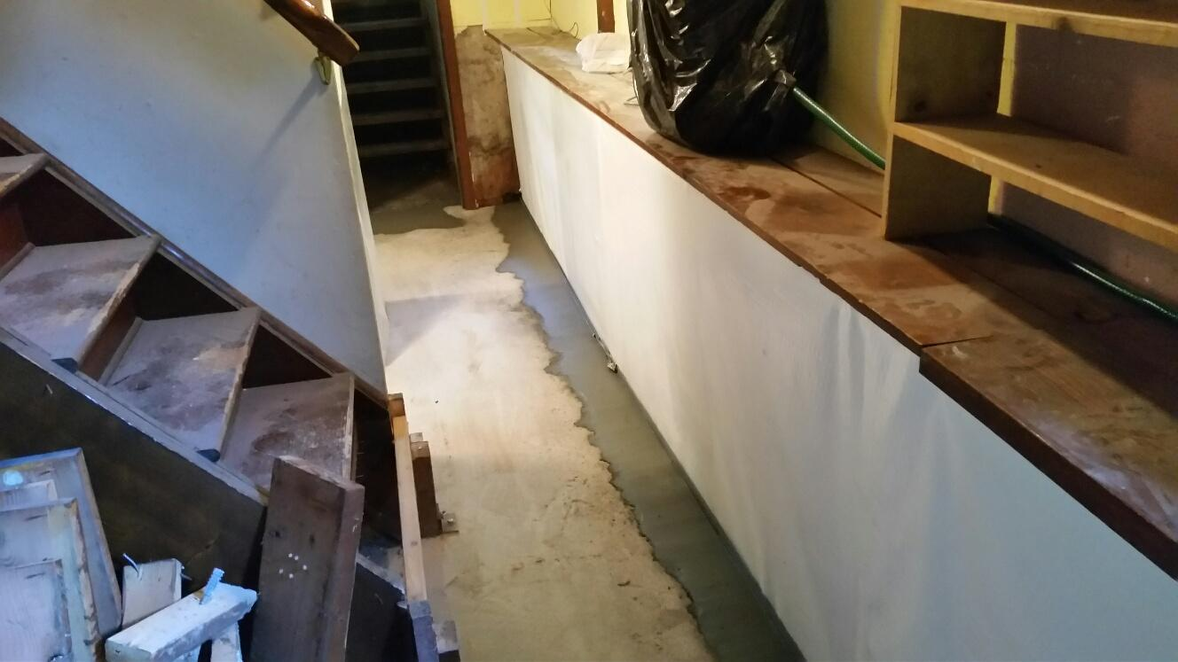 The WaterGuard in this basement is stretching alongside the perimeter, and working with our CleanSpace wall covering to keep the basement dry, and also still attractive.
