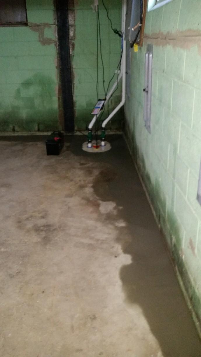 Top of the line TripleSafe sump pump was installe din this Peoria basement working with and alongisde the new WaterGuard sub-floor drainage system.
