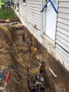 This row of push piers has been installed at the back of the house where the homeowners had noticed the sinking slabs and the sticking windows and doors.