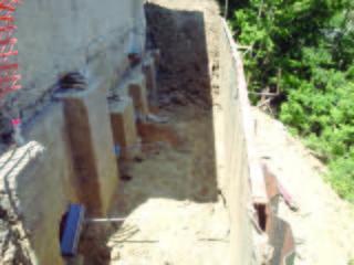 Tiebacks advanced through core holes of concrete underpinning