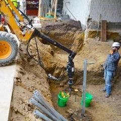 Advancing helical pile