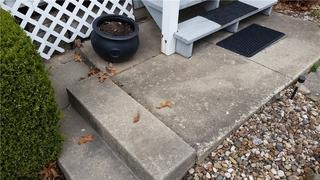 Unlevel slabs have made the stairs to the porch unsafe and unreliable.