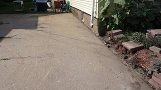 A NexusPro Joint Sealant is applied to all cracks, making the appearance of the driveway faults disappear.