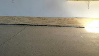 Voids from settled and compressed soils have left the garage slab to sink, leaving gaps in the foundation.