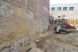 Exposed foundation wall of existing building